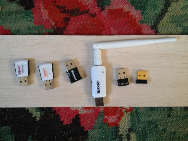 A selection of wifi cards: left to right: Wipi, Comfast, Micronet, Tenda, Loglink, Edimax